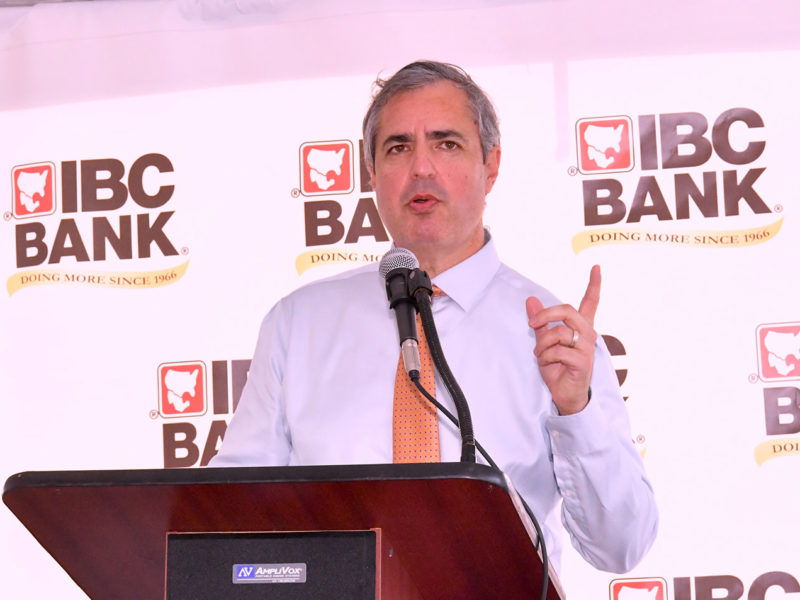 "Adrian Villarreal, President of IBC Bank launching the ""Neighbors Helping Neighbors"" in Weslaco. IBC donated $1,000 to First Baptist Church for their participation helping residents during the floods. Photo Roberto Hugo Gonzalez"
